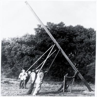 Archive photo from NRECA of Co-op workers setting an electric pole